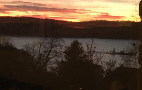 A view from Broadway of the sunset above the Hudson River in Dobbs Ferry.